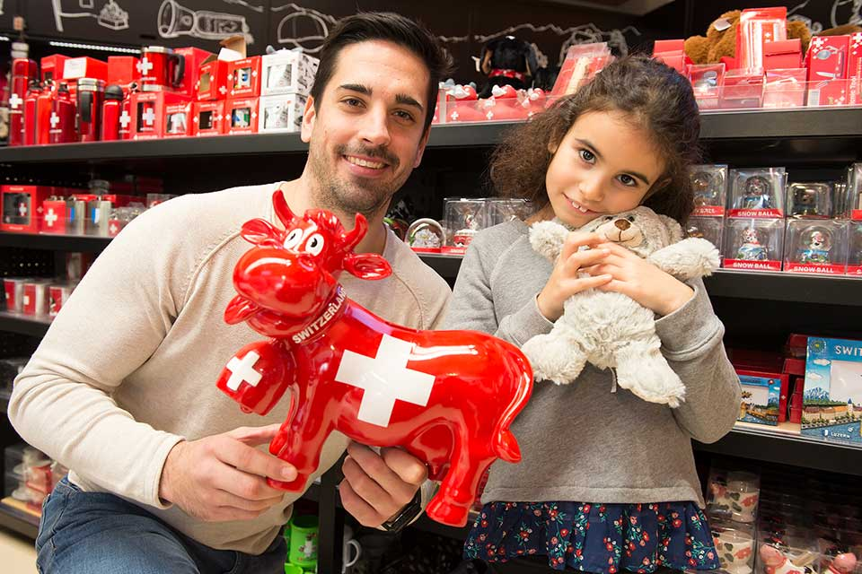 Father and daughter enjoy a gift each from the shop