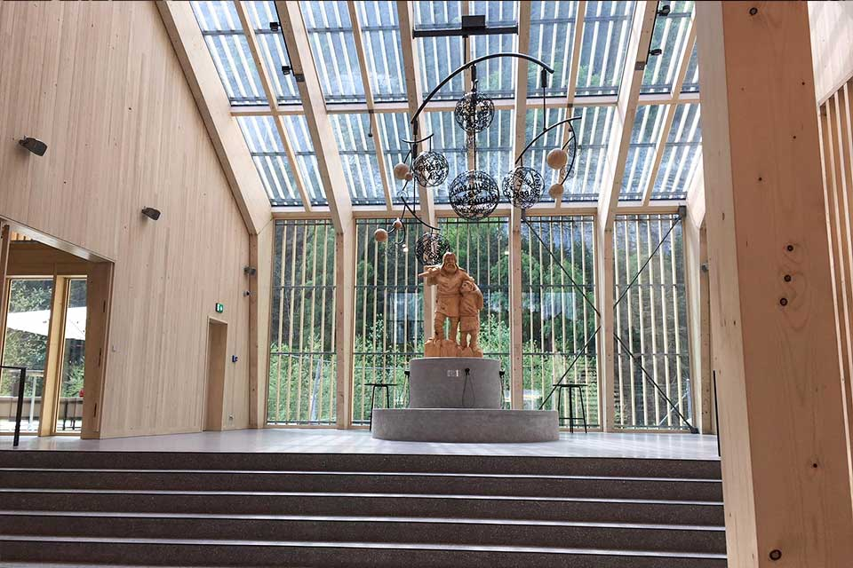 View into the entry hall with William Tell sculpture and wood and glass roof